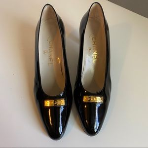 Chanel black patent leather heels gold bar heels